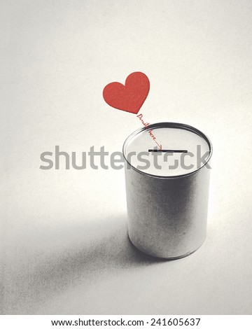 heart symbol and donation can (retro style) - stock photo
