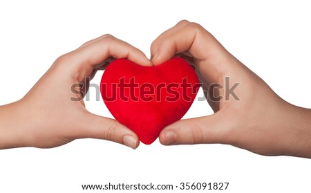 Heart symbol in woman hands isolated on white background - stock photo
