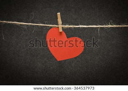 heart  to a rope with clothespin - stock photo
