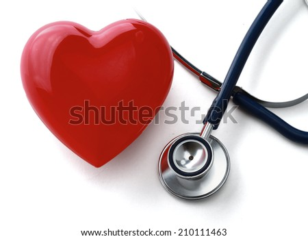 Heart with a stethoscope, isolated on white background - stock photo