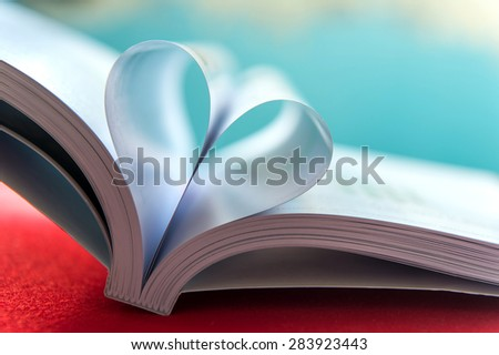 Heart with book pages.soft focus - stock photo
