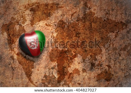 heart with national flag of afghanistan on a vintage world map crack paper background. concept - stock photo