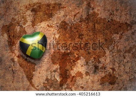 heart with national flag of jamaica on a vintage world map crack paper background. concept - stock photo