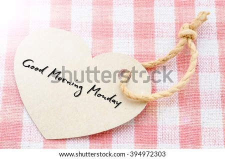 Heart with text Good morning Monday on tablecloth. - stock photo