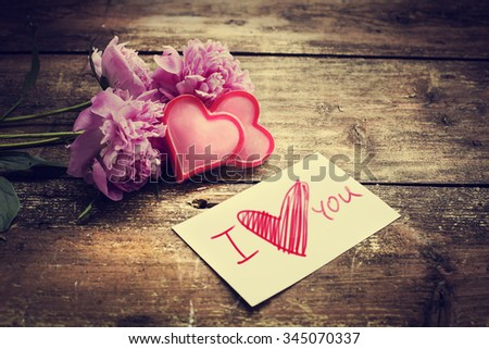 hearts and a bouquet of  peonies on wooden board, Valentines Day background - stock photo