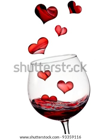 Hearts flying in glass with red wine - stock photo
