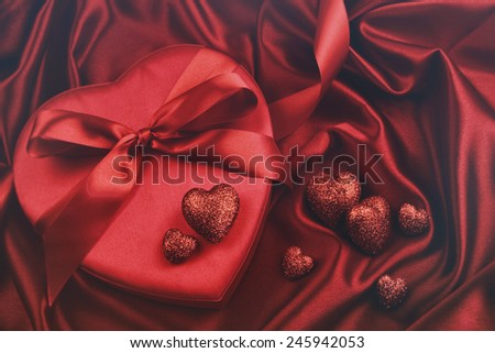 Hearts for valentines Day on satin background - stock photo