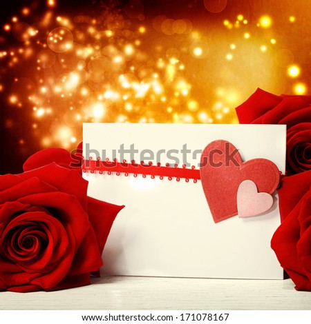 Hearts greeting card with beautiful red roses over abstract lights background - stock photo