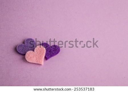 hearts on purple - stock photo