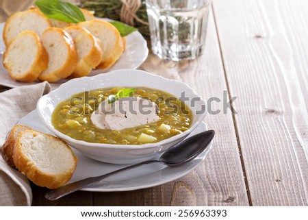 Hearty and thick chicken split pea soup - stock photo
