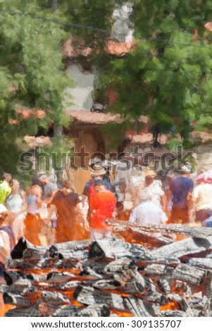 Heat haze created by big pile of wood set on fire. The haze is creating interesting blur effect on the background. - stock photo