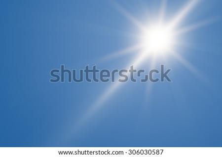 Heat, sun shining at the clear blue sky with copy space - stock photo