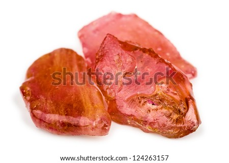 Heat treated rough ruby with lead glass or other filling. Color is pink, orange and red. Perfect example of poor quality rubys made better looking by treatment. - stock photo