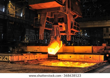 heated steel pigs the crane from takes out furnaces - stock photo