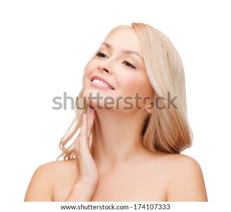heath and beauty concept - face of beautiful woman touching her neck - stock photo