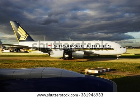 HEATHROW, ENGLAND -3 FEBRUARY 2016- A double-decker Airbus A380 super jumbo jet from Singapore Airlines (SQ) at the London Heathrow International Airport (LHR). - stock photo