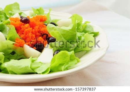 Heathy vegetable salad with butterhead, chinese pear, grape and Japanese ebi-go - stock photo