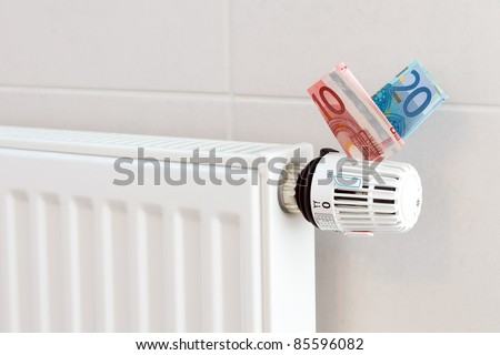 Heating thermostat with euros, expensive heating concept - stock photo