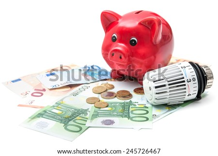 Heating thermostat with piggy bank and money, expensive heating costs concept - stock photo
