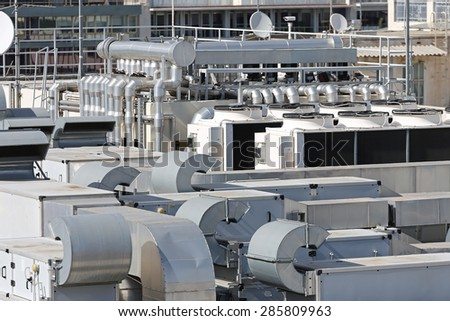Heating Ventilation and Air Conditioning at Building Roof - stock photo
