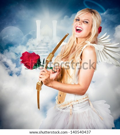 Heavenly angel of love laughing with halo on head in front of the gates of heaven. Love is the key. - stock photo