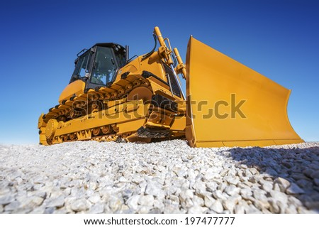 Heavy Bulldozer and deep blue sky - stock photo