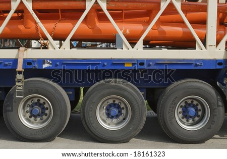 Heavy Cargo being shipped by Truck and Trailer - stock photo