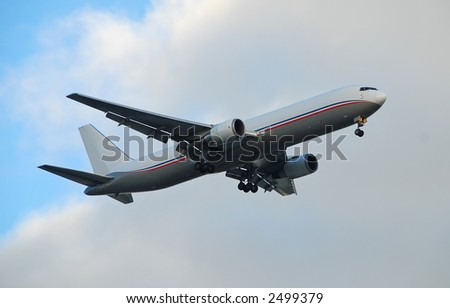 Heavy cargo jet at the speed of business - stock photo