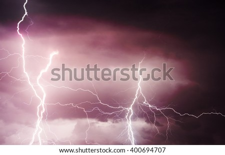 Heavy clouds bringing thunder, lightnings, storm and rain. - stock photo