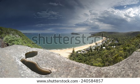 Heavy clouds loom over Pearl Beach and Broken Bay Central Coast Australia.   Panoramic scenic views from the headland - stock photo
