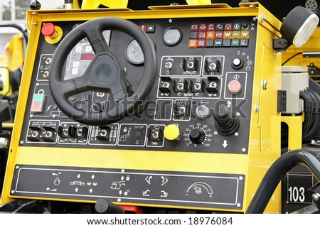 Heavy construction industry cockpit with wheel and buttons - stock photo