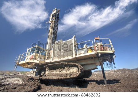Heavy drilling machine at worksite - stock photo