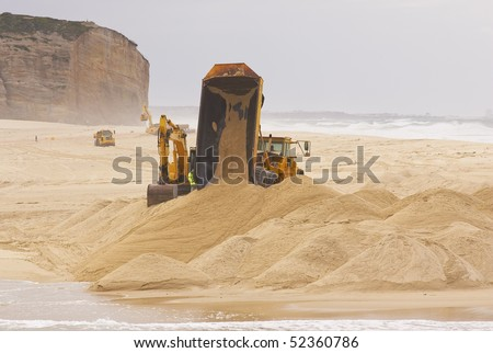 Heavy Duty construction equipment at work in the beach - stock photo