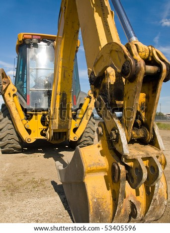 Heavy Duty construction equipment parked at work site - stock photo