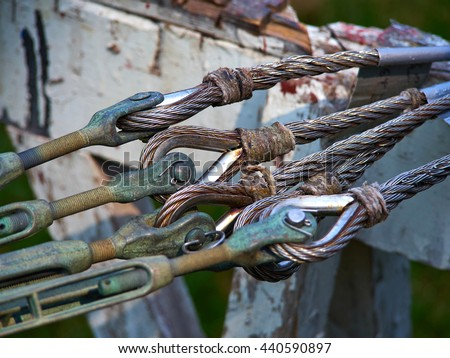 Heavy duty strong steel wire cable rope sling with safety anchor shackle used in a big sail boat - stock photo