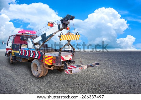 heavy duty truck used for towing on the road - stock photo