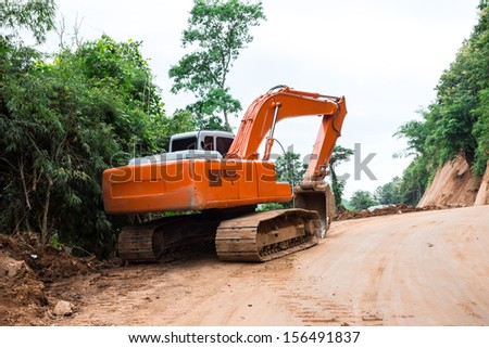 Heavy earth mover at construction site - stock photo