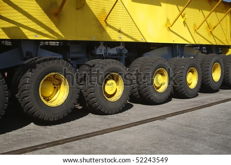 Heavy equipment. Detail of heavy equipment. Part of mobile crane. Wheels in a row - stock photo