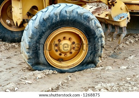 Heavy equipment flat tire - stock photo