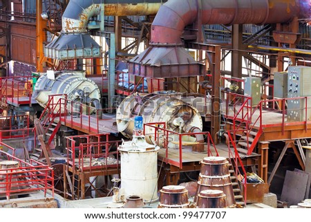 Heavy foundry equipment in casting hangar of metallurgical plant - stock photo