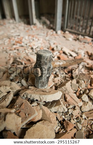 heavy hammer destroy the brick wall - stock photo