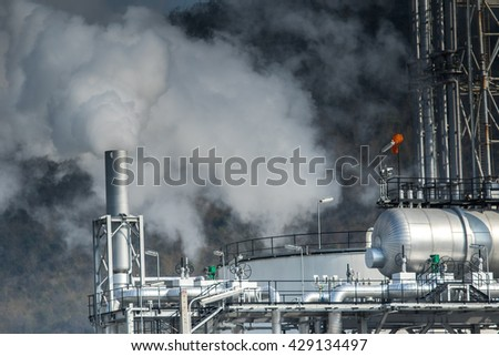 heavy industrial fog from exhaust tube in petrochemical  industry estate - stock photo