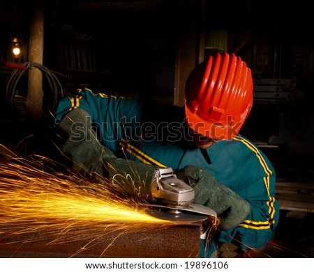 heavy industry manual worker with grinder - stock photo