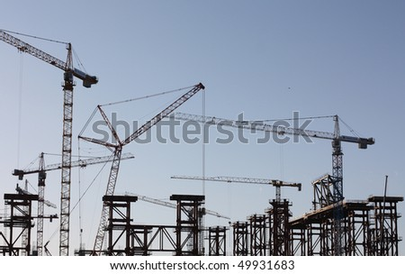 heavy machinery cranes - stock photo