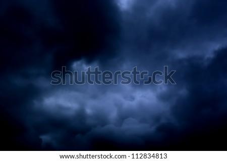 heavy massive clouds overcast day - stock photo