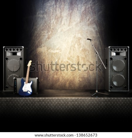 Heavy metal music stage or singing background, microphone, electric guitar and speakers with diamond plated flooring. Advertising concept with room for text or copy space - stock photo