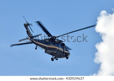 Heavy patrol helicopter rear view - stock photo