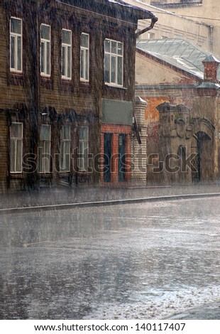 Heavy rain in the old town in Central Russia - stock photo