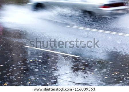 Heavy rain on city street - stock photo