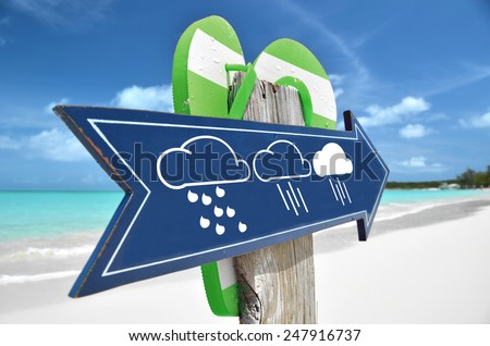 HEAVY RAINS AHEAD sign on the beach - stock photo